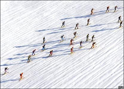 Participants climb to a high pass during a ski-climbing race
