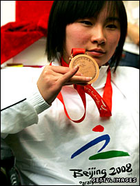 Chinese athlete Wu Qi with a Beijing Paralympic medal