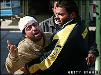Iraqi man cries after losing his brother in bomb attack, 01 February 2008