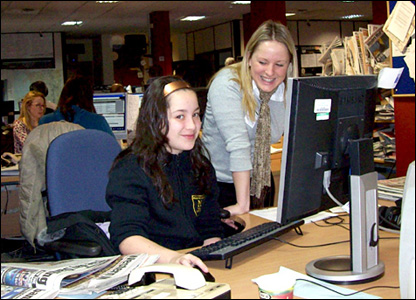 Maesteg Comprehensive School pupil Dayna, 11, begins work watched by English teacher Claire Manson.