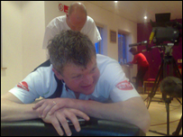 Adrian Chiles gets a well deserved rub-down in Doncaster