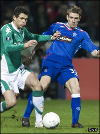 Rangers' Steve Davis (right) is challenged by Sebastian Boenisch