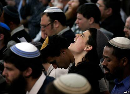 Orthodox Jews pray during a memorial service at the Mercaz Harav seminary