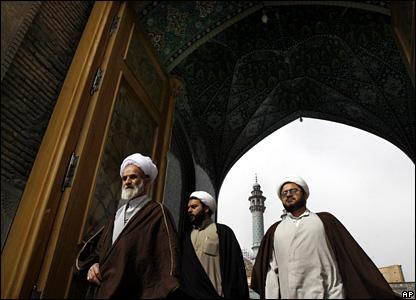 Clerics leave the 16th Century shrine of Hazarat-e Masumeh (the Pure Saint) in the Iranian city of Qom