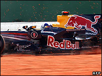 David Coulthard slides into a gravel trap in his Red Bull