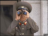 North Korean borderguard keeps an eye out