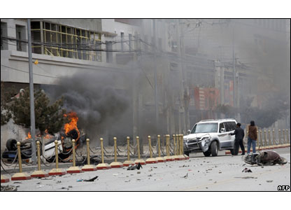 A car burns on a street in the Tibetan capital Lhasa