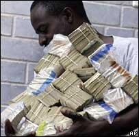 Man carrying bundles of banknotes