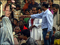 Dr Kamal Kar speaking to villagers (Image: TVE)