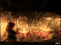 A child lights a candle during a demonstration in Gaza