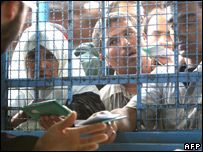 Gazans wait to receive food vouchers