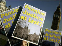 Placards raised during a pension protest in Parliament Square - credit: Andrew Parsons/PAWire