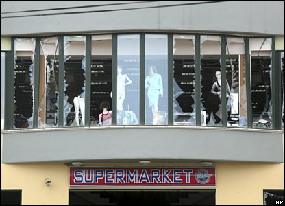 Shattered shop window near site of blast