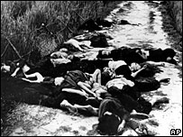 Bodies of women and children lie in the road leading to the village of My Lai, following the massacre