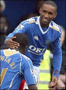 Defoe celebrates his strike