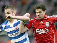Kevin Doyle and Xabi Alonso link arms
