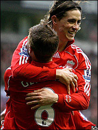 Liverpool striker Fernando Torres celebrates Steven Gerrard
