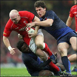 Wales centre Tom Shanklin causes problems for France