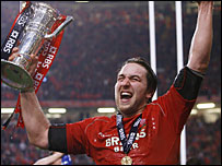 Ryan Jones holds the Six Nations trophy aloft after leading Wales to victory