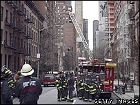 Firefighters look at collapsed crane in New York