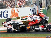Giancarlo Fisichella's Force India is launched into the air by Nelson Piquet Jr's Renault at the first corner of the Australian Grand Prix