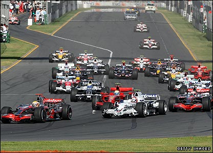 Cars race towards the first corner at the start of the Australian Grand Prix