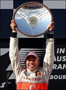 Lewis Hamilton holds his prize aloft
