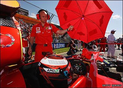 Kimi Raikkonen tries to get some shade