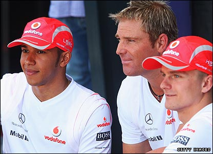 Shane Warne (centre) with Lewis Hamilton and Heikke Kovalainen