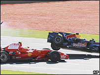 Felipe Massa's Ferrari collides with David Coulthard's Red Bull during the Australian Grand Prix
