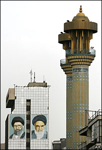 Murals in Tehran of Iran's Supreme Leader Ayatollah Khamenei (L) and the late Ayatollah Khomenei (R)