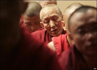 A Tibetan monk prays in Dharamsala, 16 March 2008