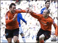 Noel Hunt scores the opening goal for United