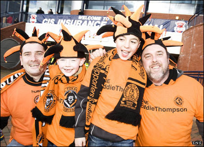 Some Dundee United fans prepare to cheer on their team at Hampden