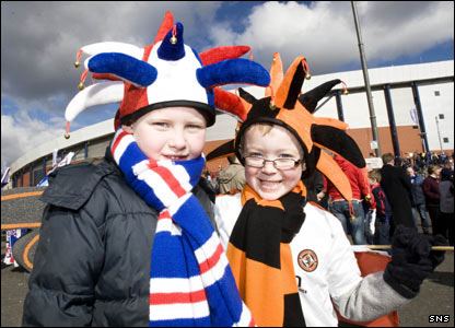 Two young fans get ready to cheer on their respective teams at Hampden