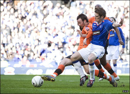 United open the scoring as Noel Hunt brushes off a challenge to stab the ball towards the Rangers goal
