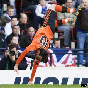 Noel Hunt performs one of his trademark somersaults after scoring against Rangers