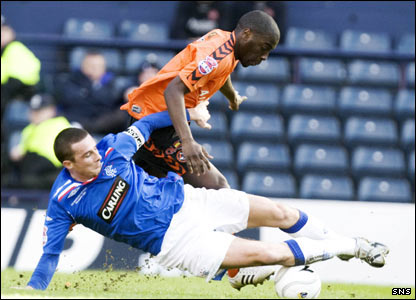 Barry Ferguson beats Dundee United's Morgaro Gomis to the ball with a sliding challenge