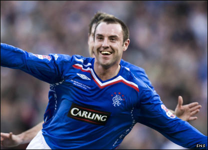 Boyd turns to the Rangers support to celebrate scoring the goal that put the final into extra-time