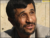 Mahmoud Ahmadinejad smiles as he fills in his ballot paper, Tehran, 14 March 2008