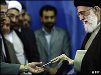 Ayatollah Ali Khamenei shows his birth certificate before voting in Tehran, 14 March 2008