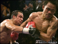 Manny Pacquiao (right) had to take considerable punishment