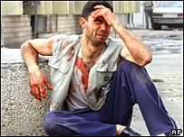 A man weeps after a bombing in the Baghdad area in 2005
