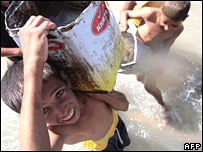 Iraqi children gather filthy water in Baghdad in September 2007
