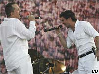 Miguel Bose of Spain performs with Colombia's Juanes