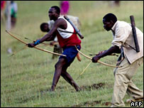 Kenyans fighting with bows and arrows