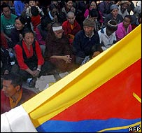 Exiled Tibetan protesters take part in a prayer vigil in Kathmandu