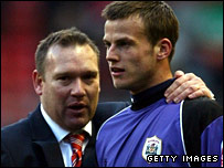 Luke Steele (right) is congratulated by Barnsley manager Simon Davey
