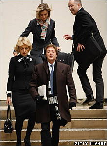 Sir Paul McCartney and his legal team