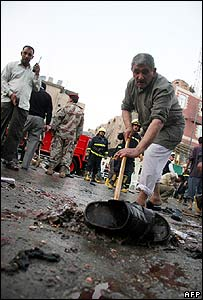 Blood is removed from the scene of the bomb attack in Karbala